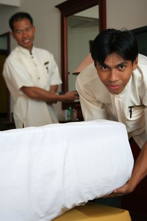 hotel staff: two room boy or housekeeping in action Stock Photo