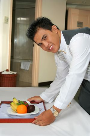 hospitality staff: room service staff or butler or waiter Stock Photo