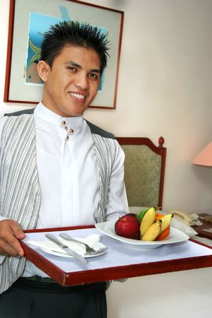room service: room service staff bringing fruit
