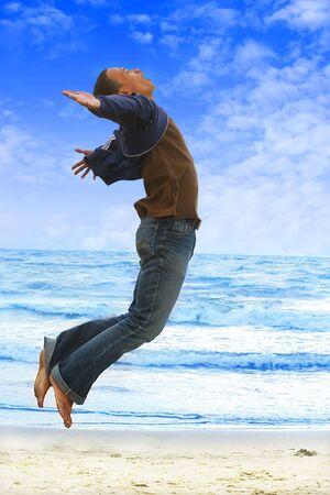 flying man: man flying on the beach