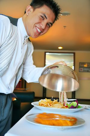 room service: room service waiter showing the food Stock Photo