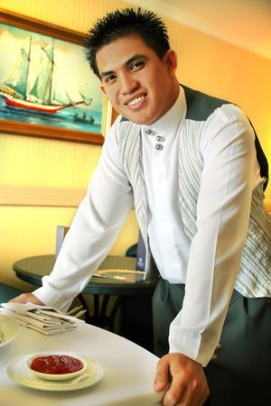 room service: room service waiter delivering food at the hotel Stock Photo