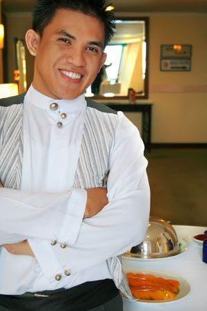 room service waiter in pose photo