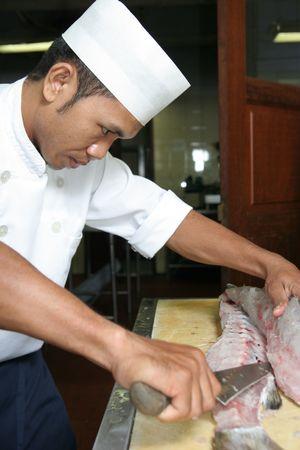 butchering: chef butchering barracuda fish