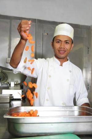 chef droping carrot photo