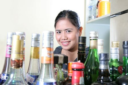 waitress with whisky or liqueurs arround her photo