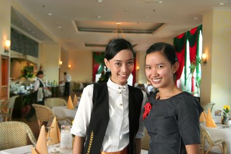 two restaurant staff at work photo