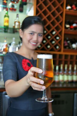 pilsener: bartender giving the beer Stock Photo