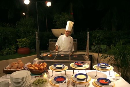 chef at buffet dinner outdoor Stock Photo