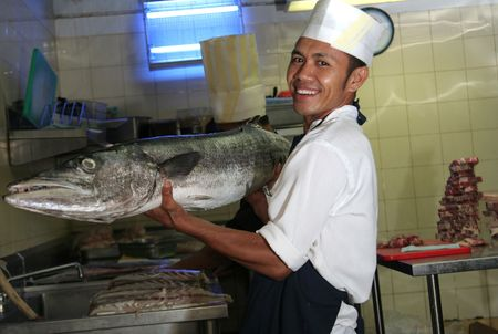 barracuda: chef holding giant barracuda fish