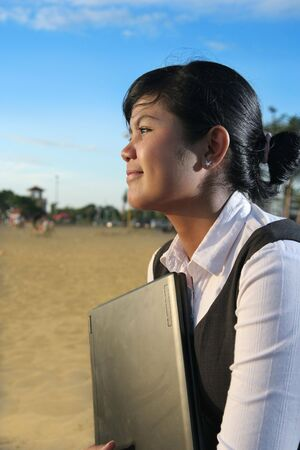 achievment: business woman at beach with laptop