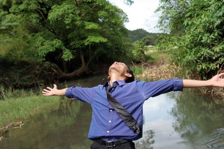 release: business man release stress on river Stock Photo