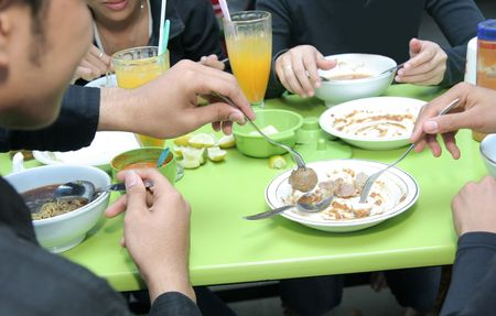 friend sharing food at cafeteria or canteen Stock Photo