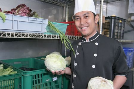 chef in vegetable store Stock Photo