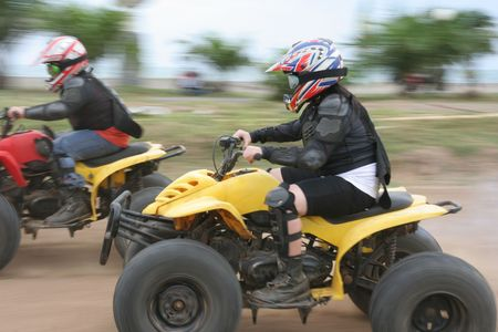 Two racer with atv or quad bike vehicle
