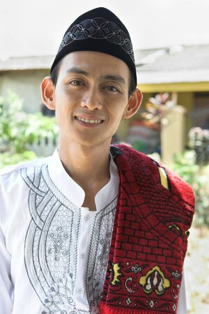 cultural and ethnic clothing: Man in muslim costume smiling