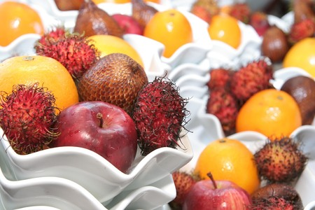 orange snake: tropical fruits on fancy bowl
