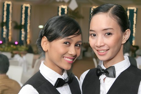 hotel staff: waitress in dinner Stock Photo