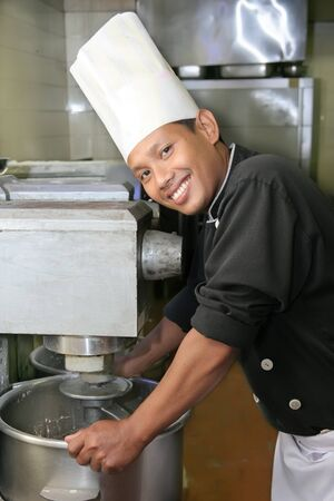 chef pastry with mixer machine smiling