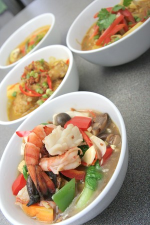 chap: asia food, seafood chap chai and curry at background