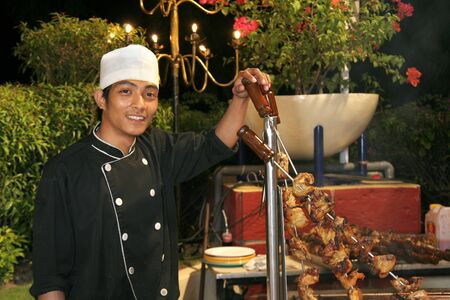 chef at barbecue dinner Stock Photo