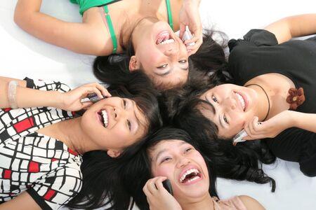 girls holding mobiles Stock Photo
