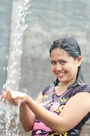 lave: Portrait Of Woman Shower Iin Water Splash Outdoor Stock Photo