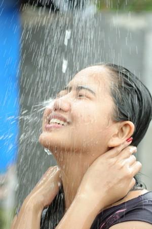 douche: Portrait Of Woman Shower Iin Water Splash Outdoor Stock Photo