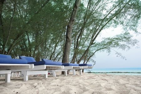 row of chairs at beach photo