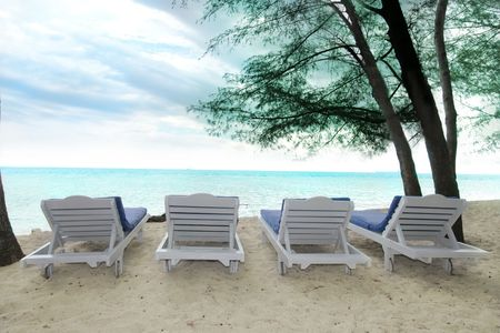row of chairs at beach Stock Photo - 5167259
