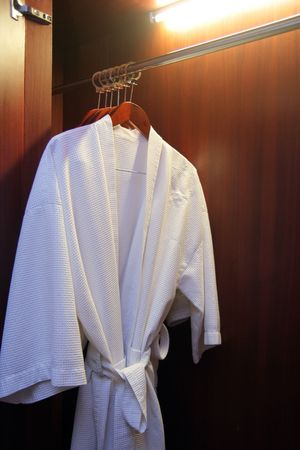 cloth hanging in cupboard Stock Photo - 5180940
