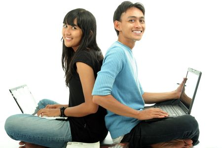 Two Asian student using laptop