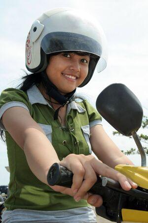 savety: Pretty woman on bike wearing helmet