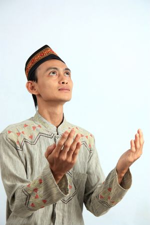 cultural and ethnic clothing: south east asia muslim praying