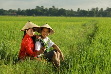 indonesia people: asian farmer at rice field