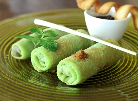 southeast asian: green crepes asian food Stock Photo