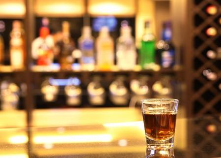 A shot of whiskey at bar Stock Photo