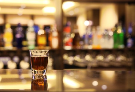 horizontal bar: A shot of whiskey at bar Stock Photo