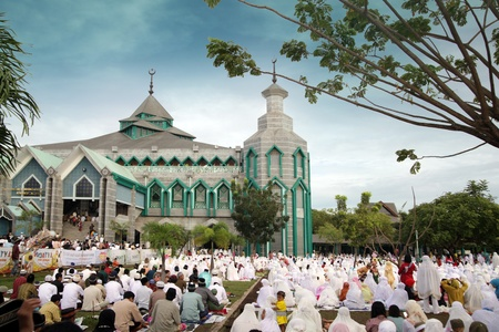 east end: Muslim pray at idul fitri or Eid al-Adha, Muslim holiday that marks the end of Ramadan. Located at indonesia south east asia