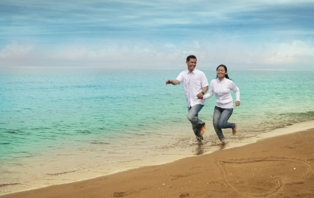 Happy asian couple at beach photo