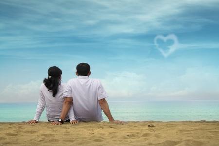 Happy couple at beach Stock Photo