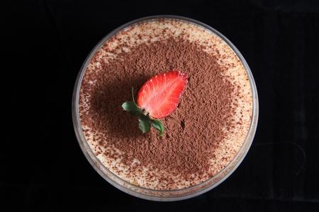 angle views: tiramisu food dessert on black background
