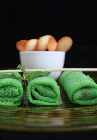 filled roll: green asian spring roll filled with coconut