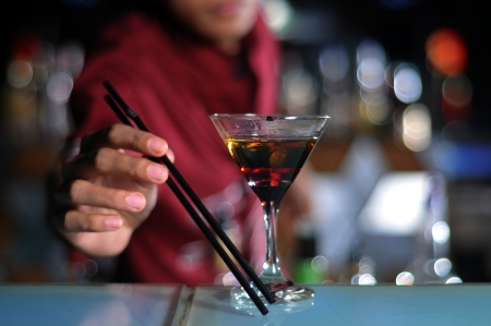 bar counters: bartender making cocktail drink at work