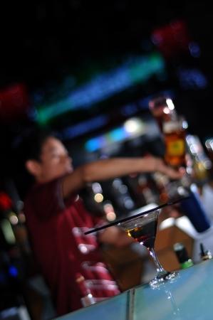 bartender making cocktail drink at work