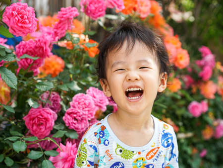 little chinese boy and flowers