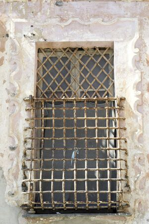 old window with iron grating Imagens