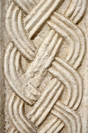 A white braid-shaped stone ornament