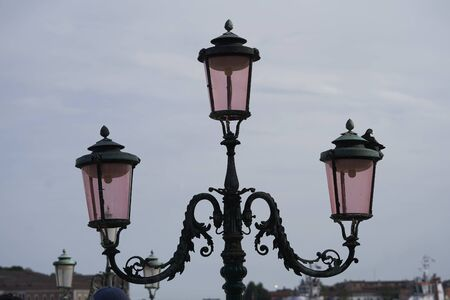 old street lamp with three arms