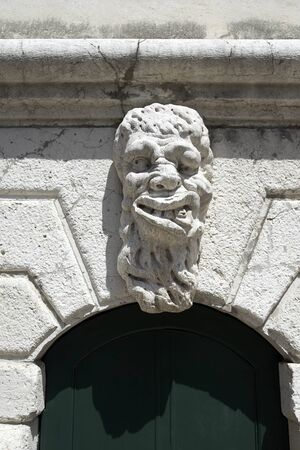 decorative mask on a door